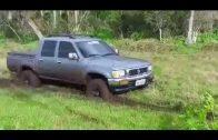 SUV Helping A Car Stuck In Mud