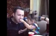 Cute Little Girl Feeding Her Father